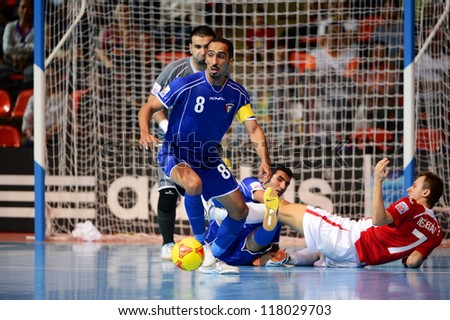 BANGKOK,THAILAND-NOVEMBER 3:Aman Salem (no.8 blue) of Kuwait in action during the FIFA Futsal World Cup between Czech Republic and Kuwait at Indoor Stadium Huamark on Nov3, 2012 in Thailand.