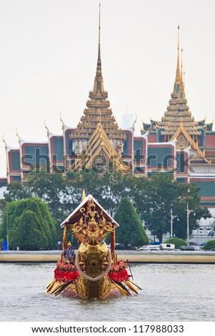 BANGKOK,THAILAND-NOVEMBER 6:Decorated barge parades past the Grand Palace at the Chao Phraya River during rehearsal of Royal Barge Procession on Nov. 6, 2012 in Bangkok, Thailand