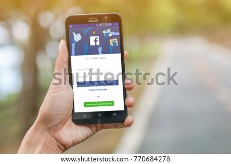 Bangkok, Thailand - November 09, 2017 : Facebook social media app logo on log-in, sign-up registration page in mobile app on hand. Illustrative Editorial.