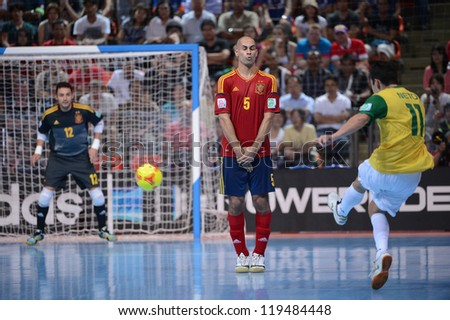 BANGKOK,THAILAND-NOVEMBER 18:Fernandao (no.5 red) of Spain in action during the FIFA Futsal World Cup Final  between Spain and Brazil at Indoor Stadium Huamark on Nov18, 2012 in Bangkok, Thailand.