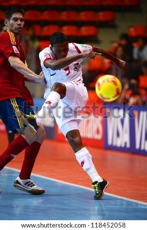 BANGKOK, THAILAND-NOVEMBER 05:Fernando Mena (white)of Panama runs with the ball during the FIFA Futsal World Cup between Spain and Panama at Indoor Stadium Huamark on Nov5, 2012 in Bangkok,Thailand.