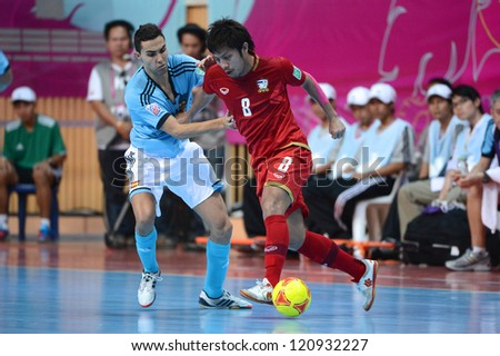 BANGKOK, THAILAND - NOVEMBER 11: Jetsada Chudech of Thailand (red) in action during the FIFA Futsal World Cup  between Thailand and Spain at Nimibutr Stadium on Nov11, 2012 in Bangkok, Thailand.