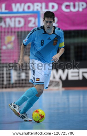 BANGKOK, THAILAND - NOVEMBER 11: Kike of Spain (blue) runs with the ball during the FIFA Futsal World Cup  between Thailand and Spain at Nimibutr Stadium on Nov11, 2012 in,Thailand.