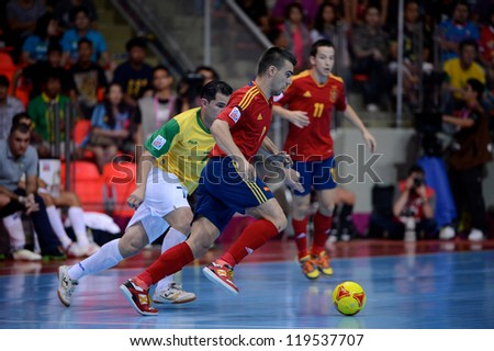 BANGKOK,THAILAND-NOVEMBER18:Kike (red) of Spain runs with the ball during the FIFA Futsal World Cup Final between Spain and Brazil at Indoor Stadium Huamark on Nov18, 2012 in,Thailand.