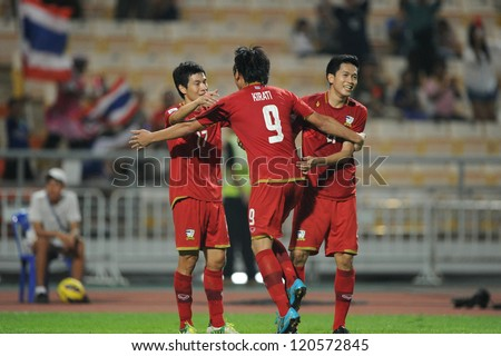 BANGKOK THAILAND-NOVEMBER 30:Kirati Keawsombut #9 of Thailand(red) celebrates with mate during the AFF Suzuki Cup between Vietnam and Thailand at Rajamangala stadium on Nov30,2012 in Bangkok,Thailand. - stock photo