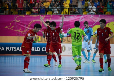 BANGKOK, THAILAND - NOVEMBER 11: Kritsada Wongkaeo #7of Thailand celebrates after scoring during the FIFA Futsal World Cup  between Thailand and Spain at Nimibutr Stadium on Nov11, 2012 in,Thailand.