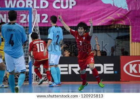 BANGKOK, THAILAND - NOVEMBER 11: Kritsada Wongkaeo #7of Thailand celebrates after scoring during the FIFA Futsal World Cup  between Thailand and Spain at Nimibutr Stadium on Nov11, 2012 in,Thailand.