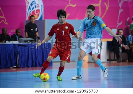 BANGKOK, THAILAND - NOVEMBER 11: Kritsada Wongkaeo of Thailand (red) runs with the ball during the FIFA Futsal World Cup  between Thailand and Spain at Nimibutr Stadium on Nov11, 2012 in,Thailand.
