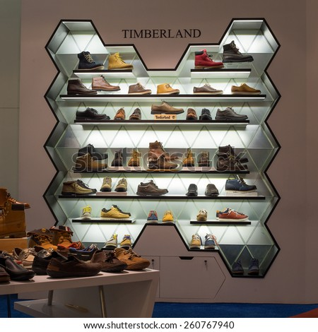 BANGKOK, THAILAND - NOVEMBER 19, 2013 : Lot shoes brand name - Timberland on a glass shelf at the Siam Paragon Mall. Siam Paragon is a one of the biggest shopping centres in Asia.