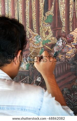 BANGKOK,THAILAND - NOVEMBER 14: Muralist repair a painting on the wall on  November 14, 2010 in Prakaew temple, Bangkok,Thailand.