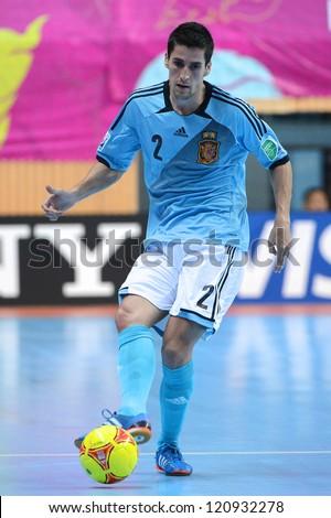 BANGKOK, THAILAND - NOVEMBER 11:Ortiz of Spain (blue) for the ball during the FIFA Futsal World Cup  between Thailand and Spain at Nimibutr Stadium on Nov11, 2012 in Bangkok,Thailand.