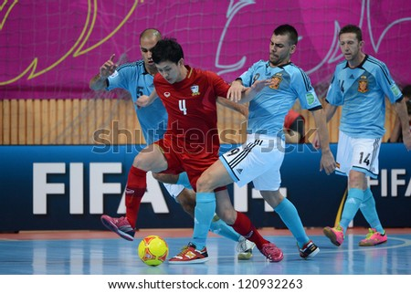 BANGKOK, THAILAND - NOVEMBER 11: Piyapan Rattana of Thailand (red) in action during the FIFA Futsal World Cup  between Thailand and Spain at Nimibutr Stadium on Nov11, 2012 in Bangkok, Thailand.