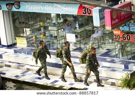 BANGKOK, THAILAND - NOVEMBER 12: Soldier walking patrol on flooded streets on Nov 12, 2011 in Bangkok, Thailand