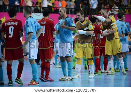 BANGKOK, THAILAND - NOVEMBER 11: Spain players (blue) in action during the FIFA Futsal World Cup  between Thailand and Spain at Nimibutr Stadium on November 11, 2012 in Bangkok, Thailand.