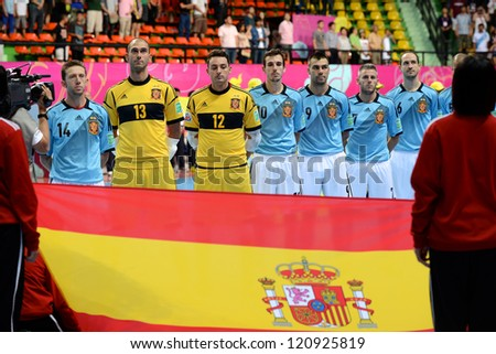BANGKOK, THAILAND - NOVEMBER 11: Spain players sing the national anthem during the FIFA Futsal World Cup  between Thailand and Spain at Nimibutr Stadium on November 11, 2012 in Bangkok, Thailand.