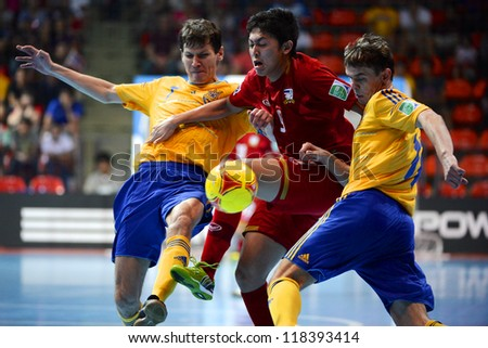 BANGKOK,THAILAND-NOVEMBER04:Suphawut Thueanklang of Thailand for the ball during the FIFA Futsal World Cup between Thailand and Ukraine at Indoor Stadium Huamark on Nov4, 2012 in,Thailand.