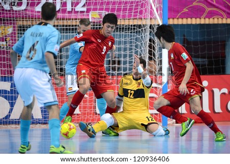 BANGKOK,THAILAND - NOVEMBER 11: Suphawut Thueanklang#9 of Thailand (red) in action during the FIFA Futsal World Cup  between Thailand and Spain at Nimibutr Stadium on Nov11, 2012 in Bangkok, Thailand.