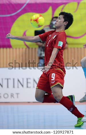 BANGKOK, THAILAND - NOVEMBER 11: Suphawut Thueanklang of Thailand (red) in actionl during the FIFA Futsal World Cup  between Thailand and Spain at Nimibutr Stadium on Nov11, 2012 in,Thailand.