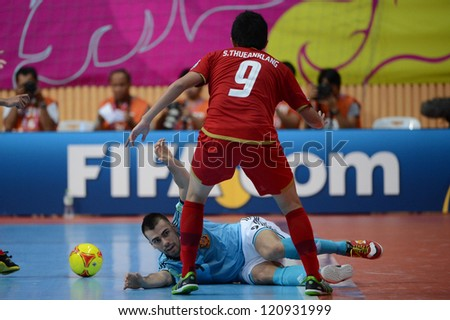 BANGKOK, THAILAND - NOVEMBER 11: Suphawut Thueanklang Thailand (red) in action during the FIFA Futsal World Cup  between Thailand and Spain at Nimibutr Stadium on Nov11, 2012 in Bangkok, Thailand.