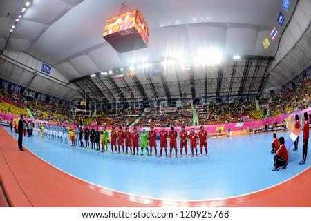 BANGKOK,THAILAND-NOVEMBER 11: Teams line up for  the national anthem during the FIFA Futsal World Cup between Thailand and Spain at Nimibutr Stadium on Nov11, 2012 in Bangkok, Thailand.