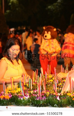 BANGKOK, THAILAND - NOVEMBER 2: Thai people buy flowers and candles to light and float on water to celebrate the Loy Krathong festival. November 2 2008 in Bangkok, Thailand.