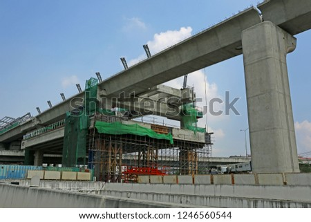 BANGKOK-THAILAND-NOVEMBER 18 : The construction of new sky train & crane of station in the city on November 18, 2018 Bangkok Province, Thailand. #1246560544