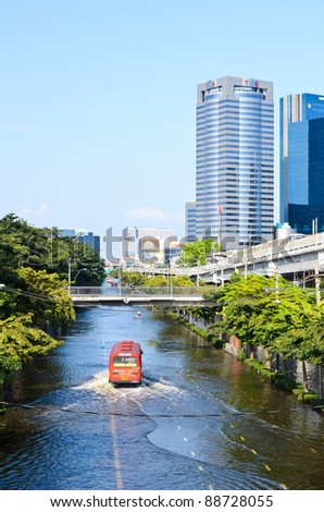 BANGKOK, THAILAND-NOVEMBER 12: Transportation of people in the streets flooded after the heaviest monsoon rain in 20 years in the capital on  November 12, 2011 Phahon Yothin Road, bangkok, Thailand. - stock photo