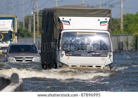 BANGKOK, THAILAND - NOVEMBER 1: Trucks navigates one of Bangkok's motorways during the worst flooding in decades in Bangkok, Thailand on November 1, 2011.