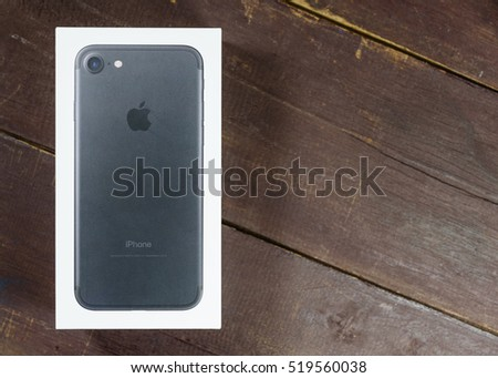 BANGKOK, THAILAND - NOVEMBER 20, 2016: Unboxing new Apple iPhone 7 on woonden backgroud, iPhone 7 is a smartphone developed by Apple Inc