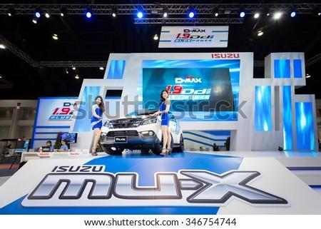 BANGKOK, THAILAND - NOVEMBER 2: Unidentified model with Isuzu car on display at The 32nd Thailand International Motor Expo on November 2, 2015 in in Bangkok, Thailand. #346754744