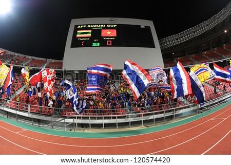 BANGKOK THAILAND-NOVEMBER 30:Unidentified of Thailand Flag supporters during the AFF Suzuki Cup between Vietnam and Thailand at Rajamangala stadium on Nov30, 2012 in Bangkok,Thailand.