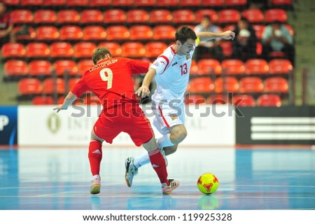 BANGKOK, THAILAND - NOVEMBER 12: Unidentified players in FIFA Futsal World Cup Round of 16 match between Russia and Czech Republic at Indoor Stadium Huamark on November 12, 2012 in Bangkok, Thailand.