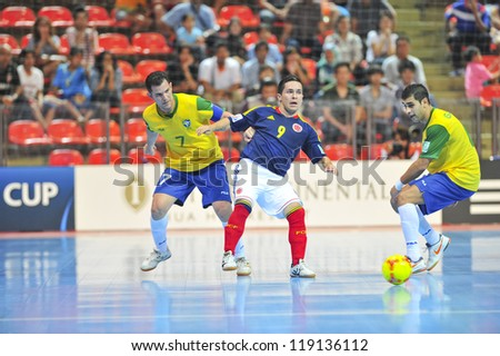 BANGKOK, THAILAND - NOVEMBER 16: Unidentified players in FIFA Futsal World Cup Semi-Final match between Brazil and Colombia at Indoor Stadium Huamark on November 16, 2012 in Bangkok, Thailand.