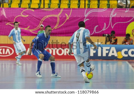 BANGKOK, THAILAND - NOVEMBER 05: Unidentified players in FIFA Futsal World Cup Thailand 2012, Group D match between Argentina and Italy at Nimibutr Stadium on November 5, 2012 in Bangkok, Thailand.