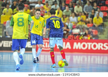 BANGKOK, THAILAND - NOVEMBER 16: Unidentified players in the FIFA Futsal World Cup Semi-Final match between Brazil and Colombia at Indoor Stadium Huamark on November 16, 2012 in Bangkok, Thailand.
