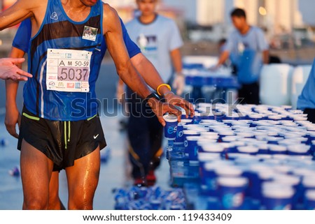 BANGKOK, THAILAND - NOVEMBER 18 : Unidentified runner competes on the street during Standard Charterd Bangkok Marathon 2012 running championship on November 18, 2012 in Bangkok, Thailand. - stock photo