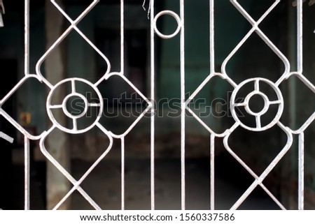 Bangkok / Thailand - November 3, 2019 :  Window grating with inside blur inside house background