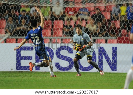 BANGKOK THAILAND-NOVENBER 24:Goalkeeper Kawin Thammasatchanan (red) of Thailand in action during the AFF Suzuki Cup between Thailand and Philippines at Rajamangala stadium on Nov24, 2012 in,Thailand.