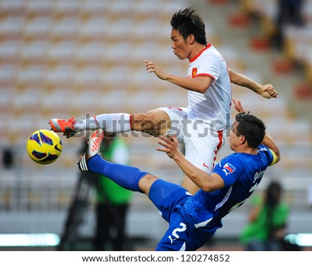 BANGKOK THAILAND-NOVENBER 27:Le Tan Tai (white) of Vietnam in action during  the AFF Suzuki Cup between Vietnam and Philippines at Rajamangala stadium on Nov27, 2012 in,Thailand. - stock photo