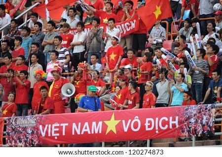 BANGKOK THAILAND-NOVENBER 27:Unidentified fans of  Vietnam supporters during the AFF Suzuki Cup between Vietnam and Philippines at Rajamangala stadium on Nov27, 2012 in,Thailand.