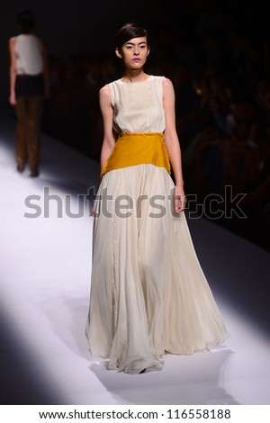 BANGKOK THAILAND-OCT12:A model walks on the catwalk showing for Vatit Itthi design by Thai designer Vatit Virashpanth and Itthi Metanee during Elle fashion week at Bangkok on Oct 12,2012 inThailand