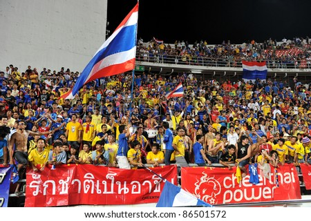 BANGKOK THAILAND - OCT 11: Football Fanclub of Thailand in action during FIFA WORLD CUP 2014 between Thailand(B) and Saudi Arabia(W) at Rajamangla Stadium on Oct 11, 2011 Bangkok, Thailand.