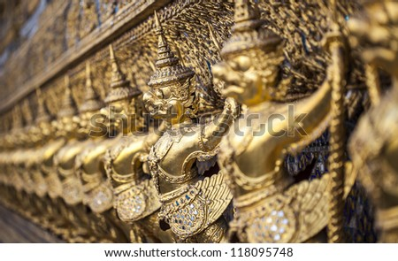 BANGKOK, THAILAND - OCT 12: Gold ornamental patter statuette in temple of emerald Buddha on 28 Oct 2012 at Grand Palace Bangkok,Thailand