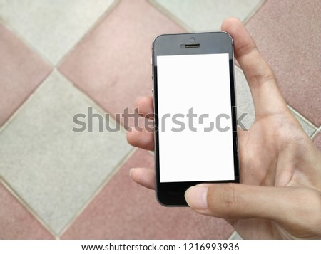 Bangkok,Thailand:Oct 2018-hand holding iphone smartphone mobile with white display is on blurred background.can be used montage for your product or graphic wallpaper.free space for text.blank form #1216993936