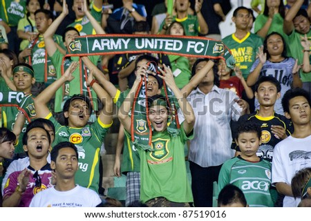 BANGKOK, THAILAND- OCT 26 : Members of the Fan club of Army Team react during Thaicom FA Cup between Army Utd. (G) vs Chonburi fc (O) on October 26, 2011 at Army Stadium in Bangkok, Thailand