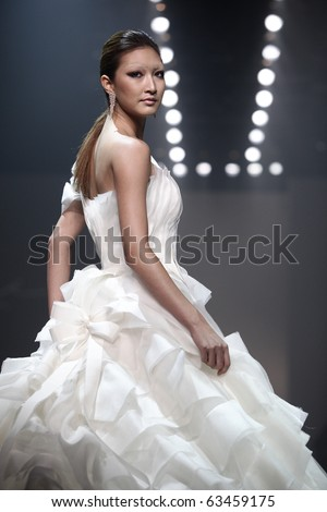 BANGKOK, THAILAND - OCT 21 :  Model showcases on the catwalk during BIFW fashion show on October 21, 2010 in Bangkok Thailand.