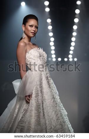 BANGKOK, THAILAND - OCT 21 :  Model showcases on the catwalk during BIFW fashion show on October 21, 2010 in Bangkok Thailand.