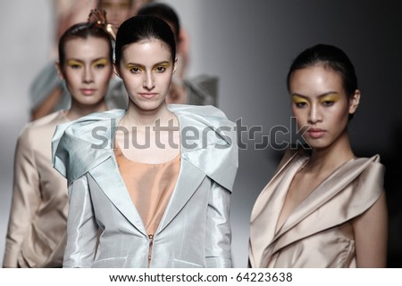 BANGKOK, THAILAND - OCT 22 : Model showcases on the catwalk during BIFW fashion show on October 22, 2010 in Bangkok Thailand.