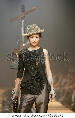 BANGKOK, THAILAND - OCT 13: Model showcases on the catwalk during ELLE fashion week on October 13, 2011 in Bangkok Thailand.