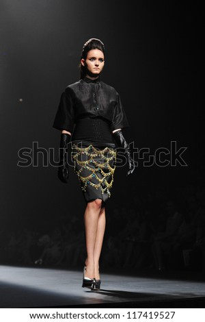 "BANGKOK, THAILAND - OCT 13 : Model walks the runway at "" Kwankao "" collection presentation during ELLE Fashion Week 2012 on October 13, 2012 in Bangkok Thailand."